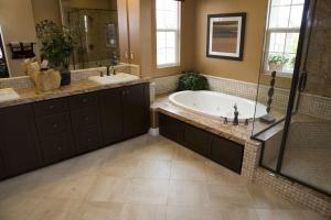 Spacious bathroom with a modern tub and tile floor.